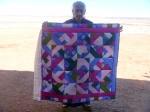 8 Caroline Tohannie w her quilt