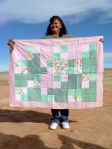 Mary Lane holding her quilt