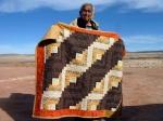 Rena Babbitt Lane holding her quilt