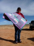 Vicky Begay holding her quilt