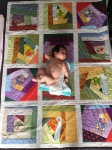 Baby on a quilt 4