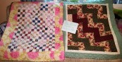 Left-Ann Drake. Right-Karisa Harriman. Both quilted by Barbara Cox