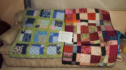 Sunshine On Line quilting group made the tops. Terri R. quilted them.